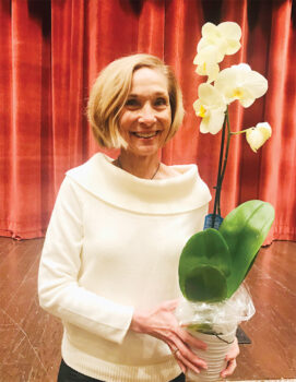 Linda Lilley, co-program chair of the RRGC, holding a Phalaenopsis orchid, also known as a 'moth orchid,' which she won.