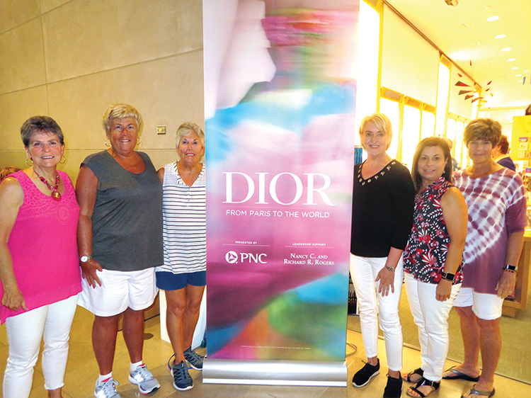 """Girls on Wheels are """"clothes"""" minded at the Dior Exhibit."""