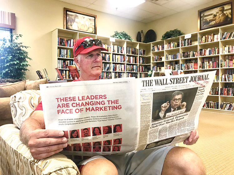 Robson residents enjoy sitting and reading the Wall Street Journal and four other publications sponsored by the Friends of the Library.