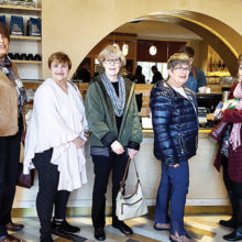 Ladies purchase coffee and muffins at the store entrance: (left to right) Diane Eoff, Nita Ice, Carol Cieslik, Rosemary Weinstein, Carol Cooley, Peggy Crandell, and Geraldine Gawle.