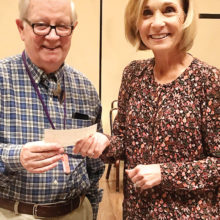 Vice President Linda Lilley presents Mr. Claud Singer with a donation to the DMGA as a gift for his presentation.