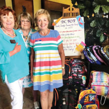 Community Relations Chair Nanci Odom presents Friends of the Family backpacks and school supplies from the Women's Club 2019 drive.