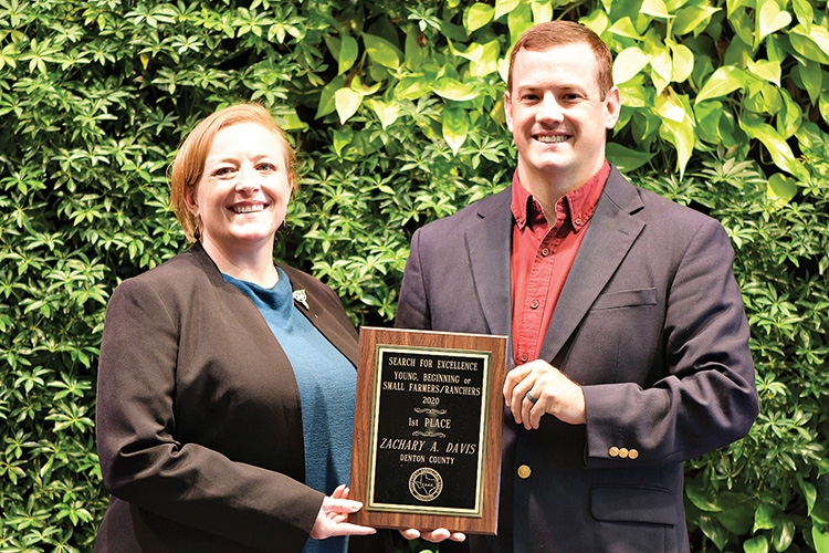 Zach A. Davis, Ag/Natural Resources Extension Agent, Denton County (right) receives a 1st place Search for Excellence award from Texas County Agricultural Agents Association President Phoenix Rogers (left) for his work with young, beginning, or small farmers and ranchers.