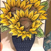 A sample of the bright, cheerful sunflower surprise pop-up cards made by the Sassy Stampers