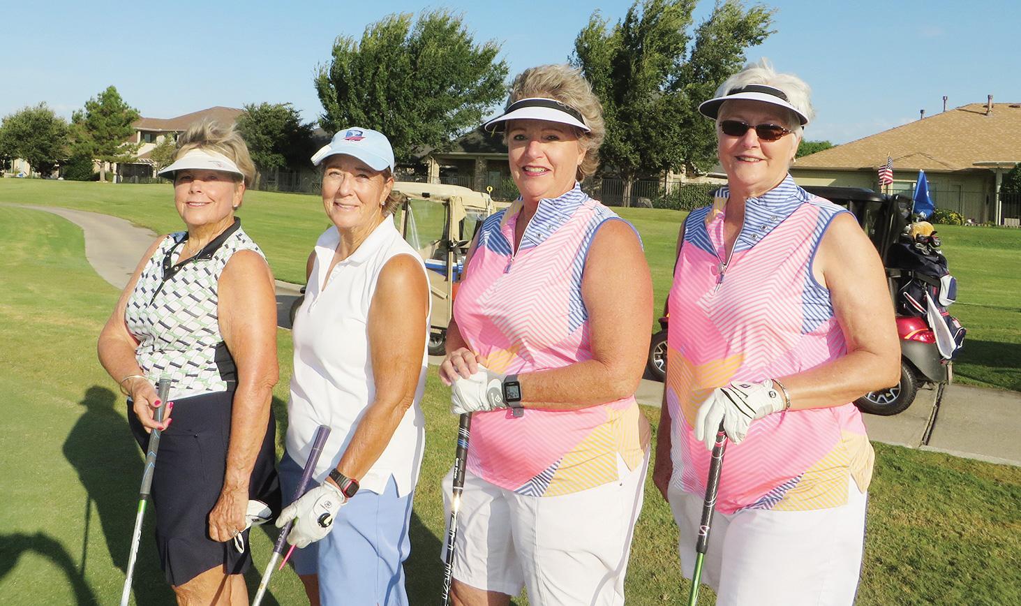 Sandy Ziegler and Paula Bone (2nd Flight Winners) along with Nancy Freisheim and Althea Parent