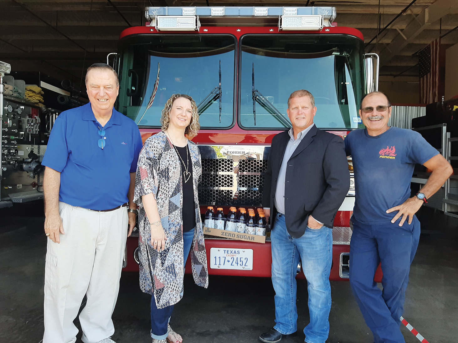 Rotary Club members Dave Everly, D'Lynn Reynolds, and Danny Fletcher and Ponder Fire Chief Andrew Economedes