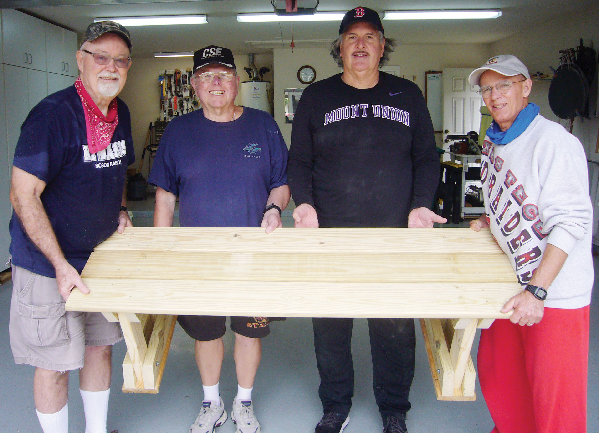 Kiwanis Club members built a bench for New Hope's rodeo arena.