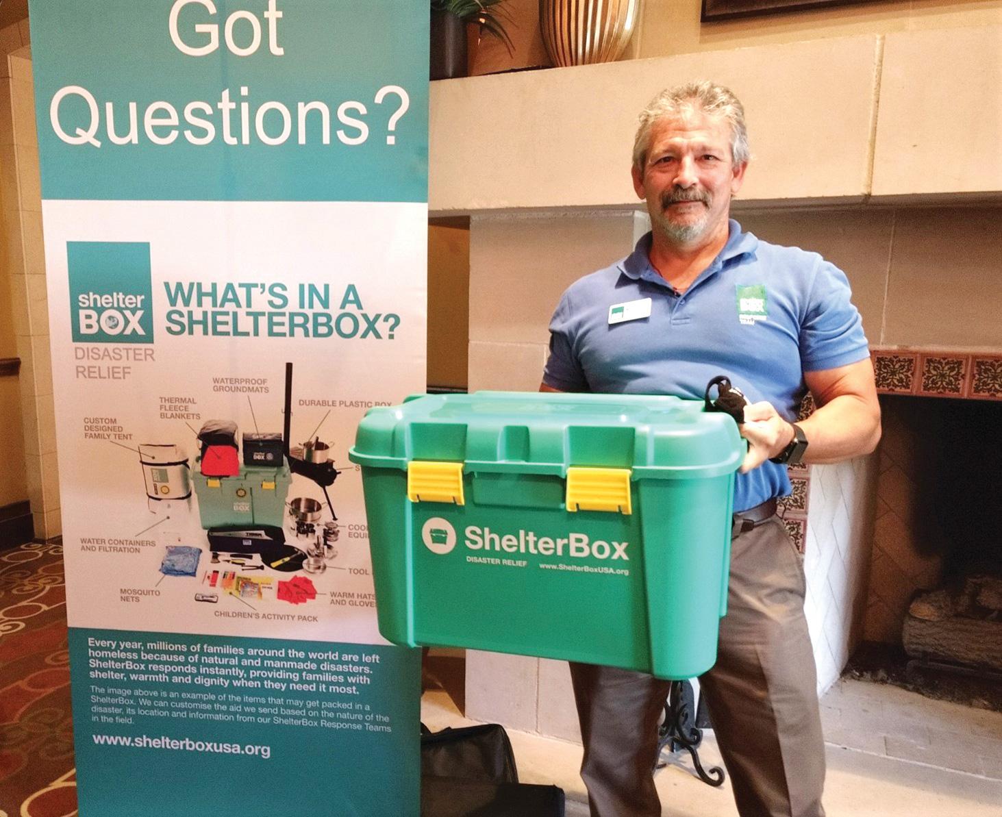 Brian Glenn shows a smaller version of the 40-gallon ShelterBox.