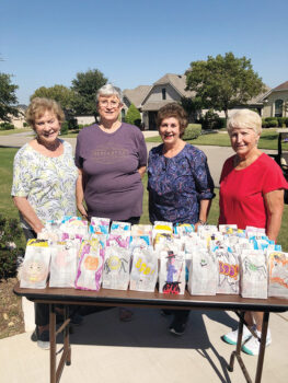 Filling the trick or treat bags (left to right): Eileen Whittaker, Marnita Torres, Darla Chupp, and Pat Hamblin
