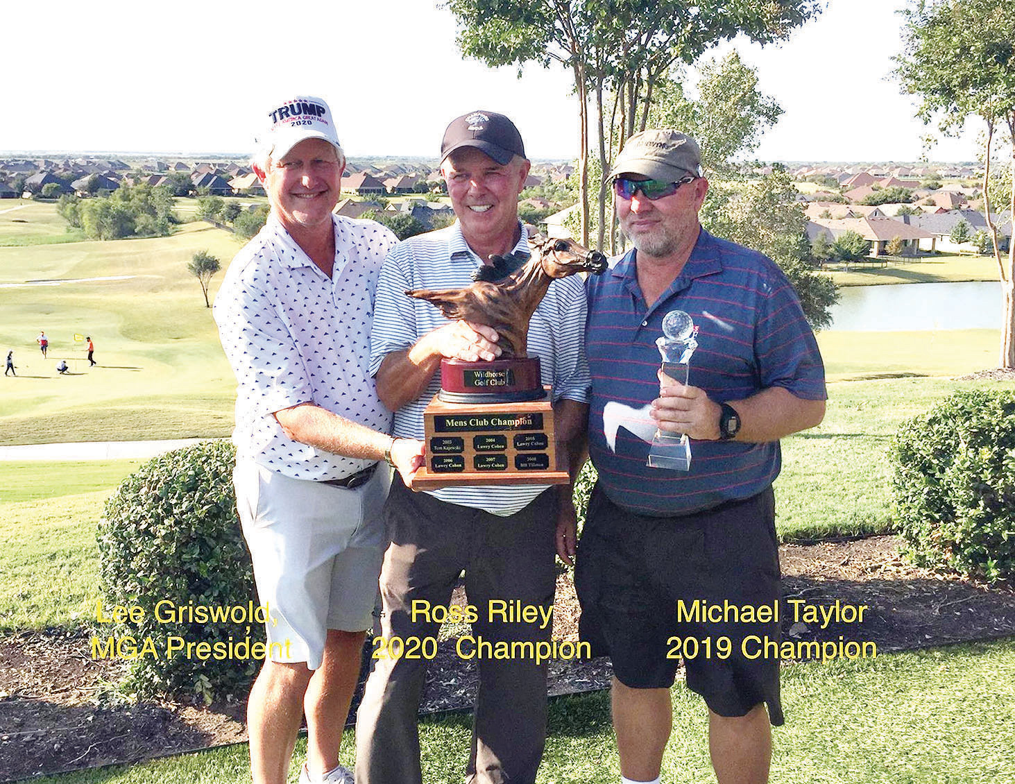 RRMGA President Lee Griswold and 2019 Champion Michael Taylor presenting the trophy to Ross Riley.
