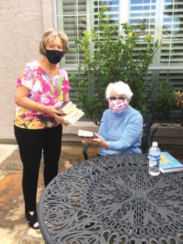 Medical conditions prevent Robson resident, Doris Lashlee, from visiting the library, so RR library board member, Sally Ryerson, regularly delivers books to her.