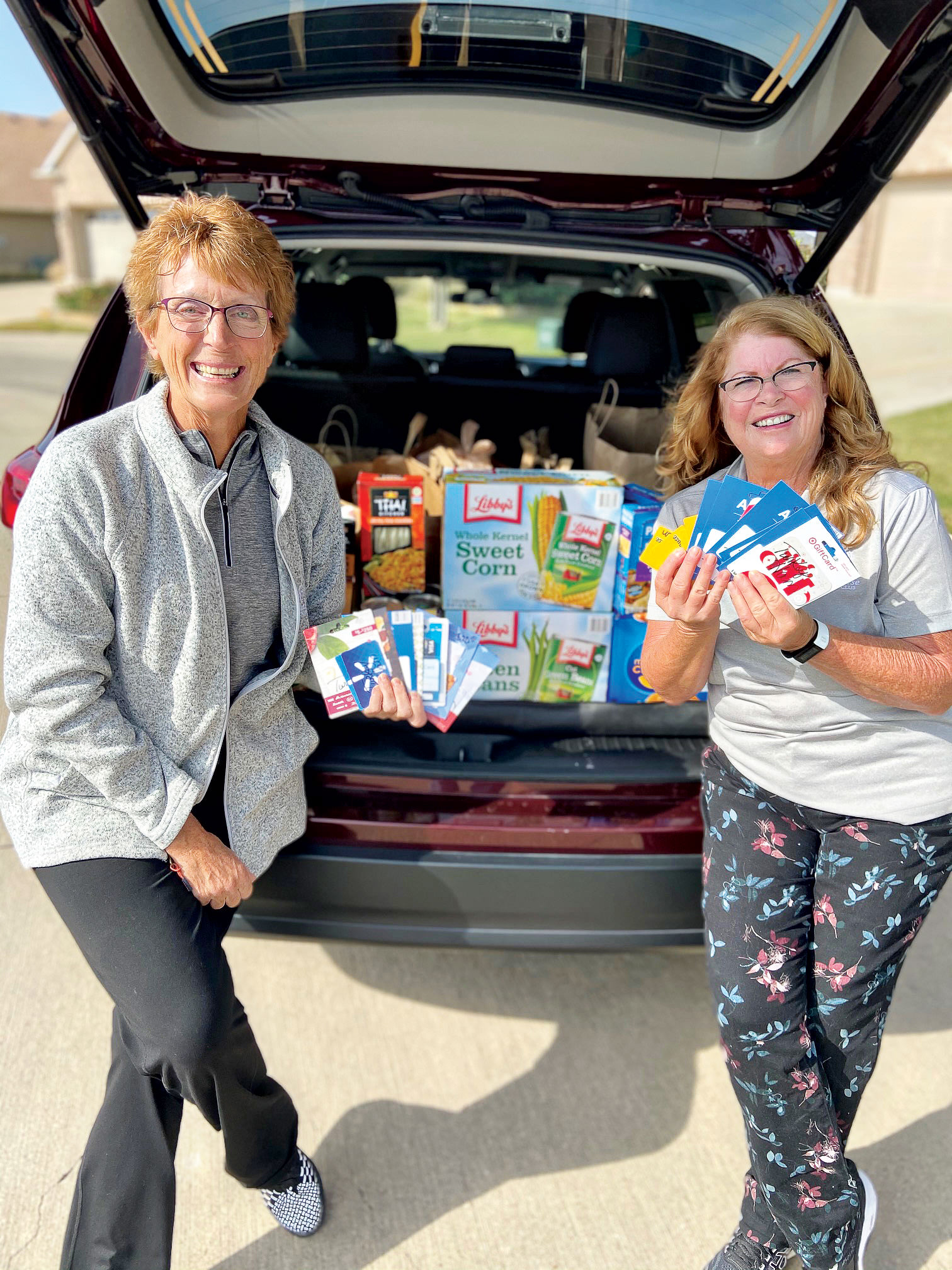 Linda Scott (left) and Cindy Sterling dropping off food and gift card donations to Our Daily Bread in Denton, Texas.