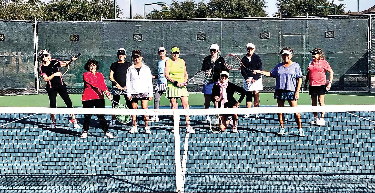Clowning around playing ladies tennis league (left to right): Debbie DiPasquaie, Anna Nallon, Julie Conant, Renee Kowalski, Lorie Blanda, Ellen Gilgore, Ineke Dabelic, Lonnie Gisis, Karen Dodrill, Janie Farda, and Dianne Ace