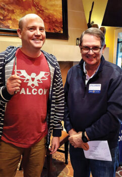 Thin Line Film Fest President Josh Butler is greeted by Rotary Chair Steve Slabaugh.