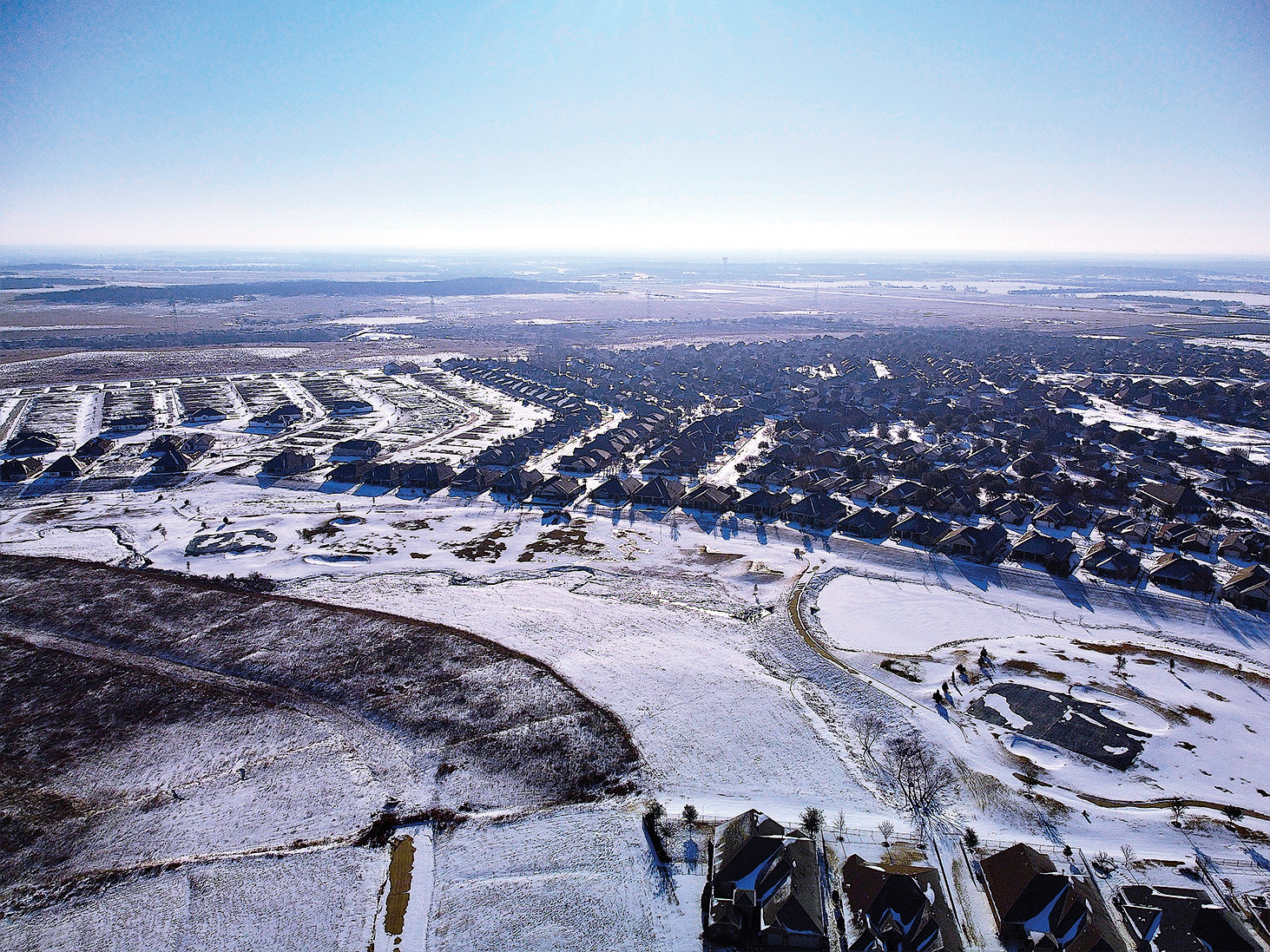 Minus 12 degrees and 40 knot gusts; photo taken on the fly as the drone passed overhead. Pond frozen and snow-covered.