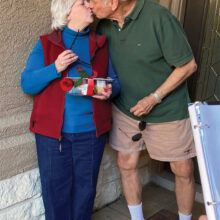 Klaus Dannenberg is giving his sweet wife Betty a loving kiss.