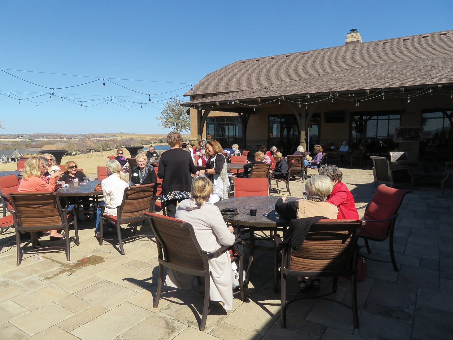 Conversation, pizza, wine, and prickly pear margaritas at the Robson Ranch Women's Club Mamma Mia Social