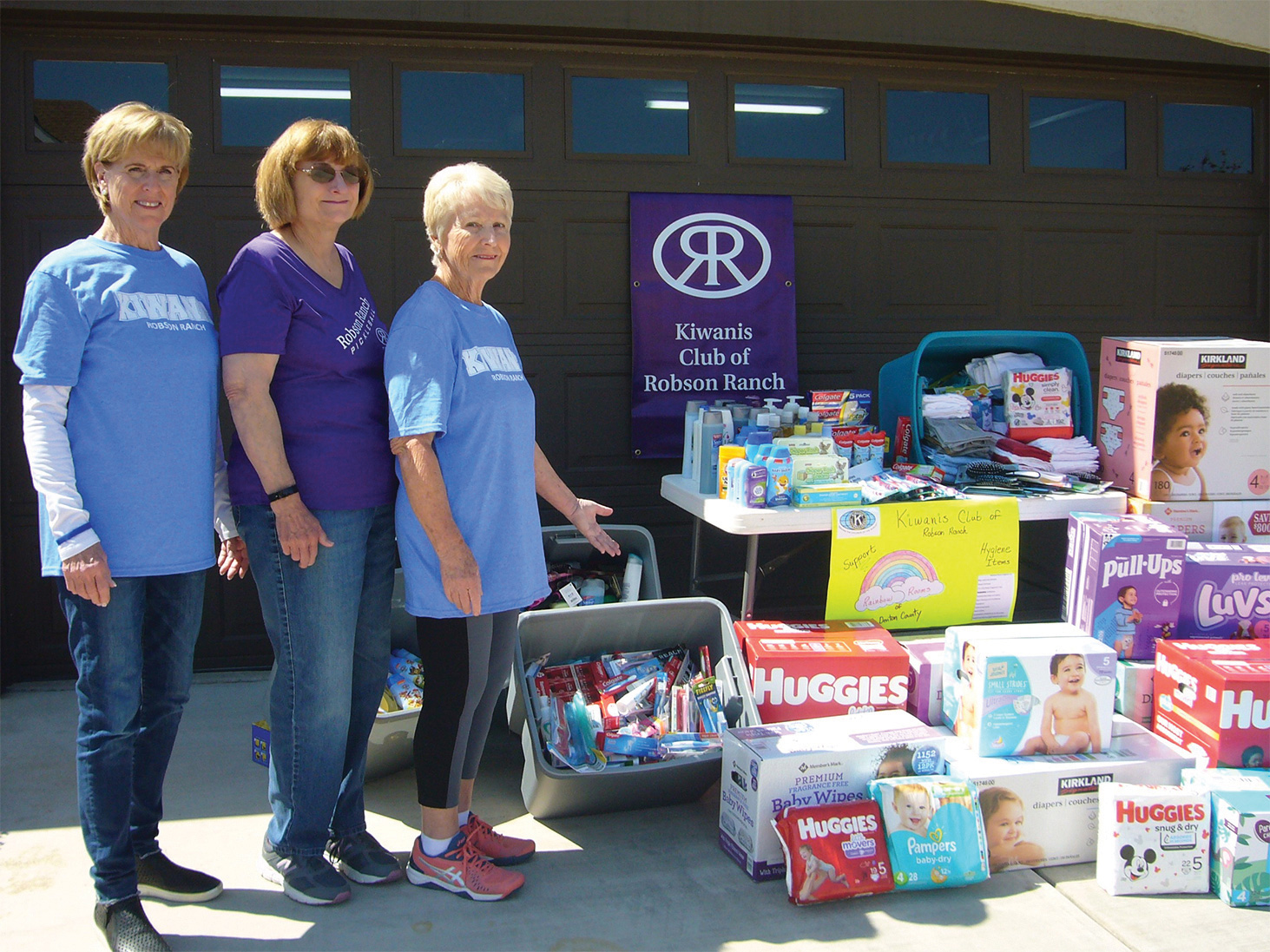 Marilyn Winter, Secretary of the RR Pickleball Club, along with Pat Hamblin and Chris Mershon, co-chairs of the Kiwanis Club Rainbow Rooms fundraiser and pickleball members show off the donations made by the pickleball members at their March 13 Shootout.