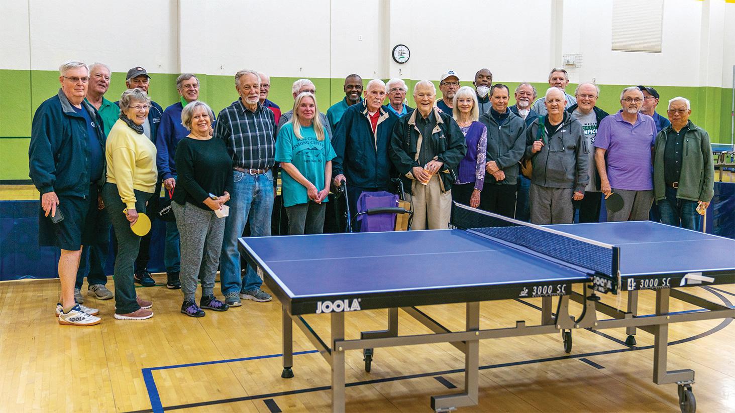 Table Tennis Club members honoring Dave Cooper.
