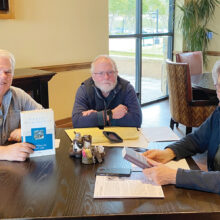 Planning session on For Whom the Bell Tolls (left to right): Alan Albarran, Mike Hall, and LaDonna Womochel