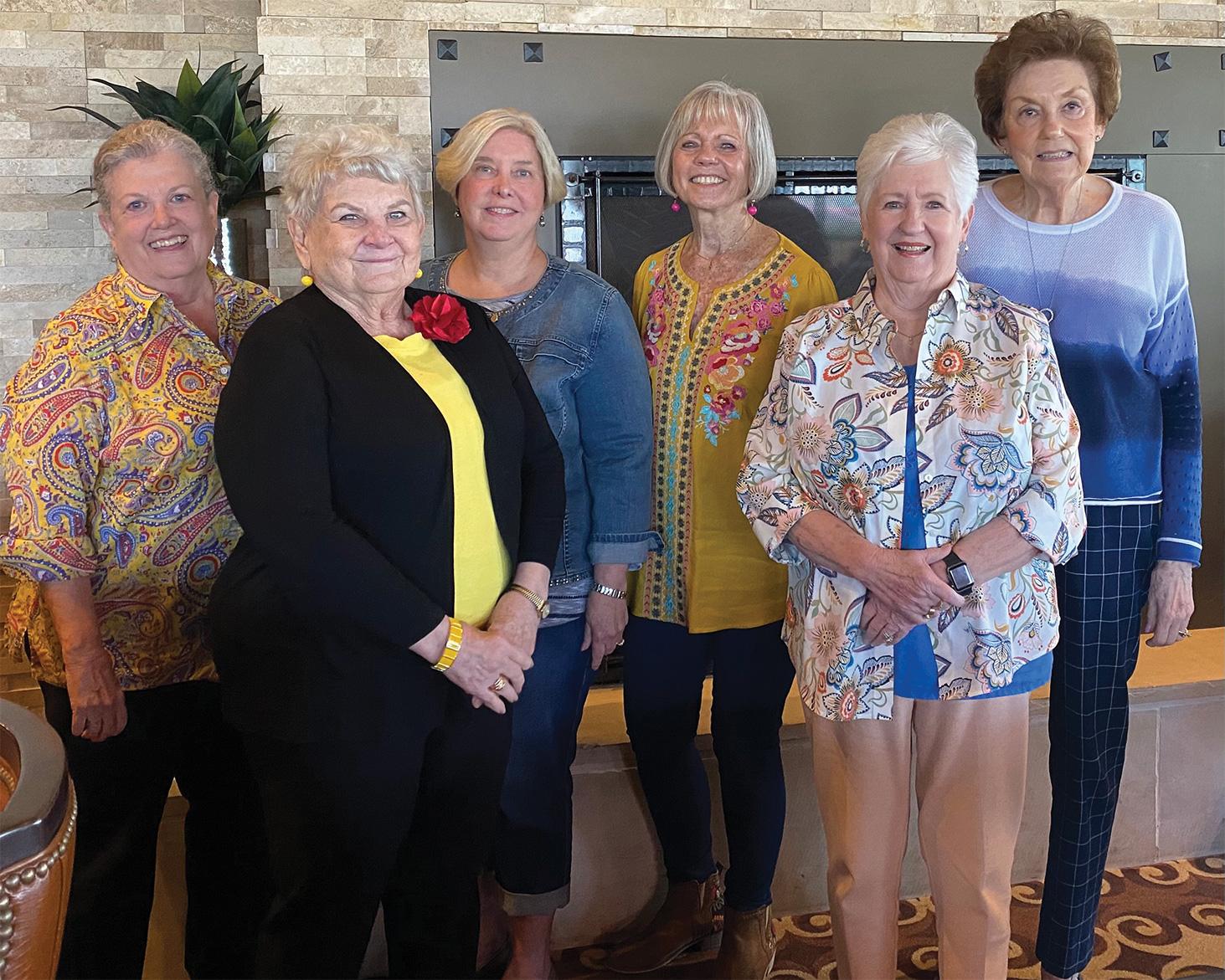 Left to right: Linda Lekawski (Oklahoma State), Jan Utzman (Oklahoma State), Sue Davis (SMU), Consie Javor (Sam Houston State), Kay Schorn (Colorado State), and Martha Fagin (University of Oklahoma); not pictured: Kathryn Stream (Vanderbilt) and Elaine Sabre (New Mexico State)