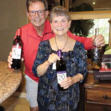 Wine Knot hosts, Vicki and Scott Baker, showcasing local artisan wines